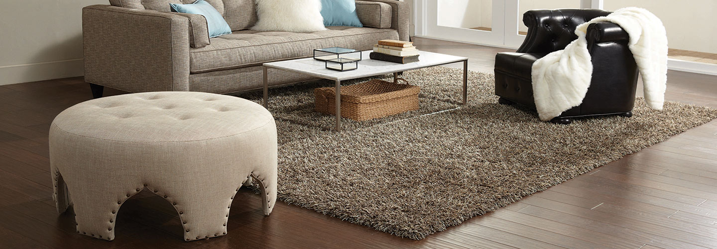 One Free 5x7 area rug with all orders on laminate, wood, & vinyl over $1999.00 at Flooring & Carpet Warehouse in Coram